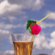 Royalty-Free Stock Photo: Cocktail with drinking straw against cloudy sky