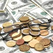 American dollars, reading glasses and various coins — Stock Photo #4368708