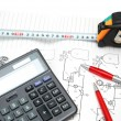 Stock Photo: Calculator and pencils over the engineering drawings