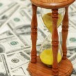 "Stock Photo: Time is money"" with dollar notes and hourglass"