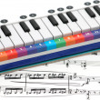 Notes and piano with numbered colourful keys — Stock Photo #4368994