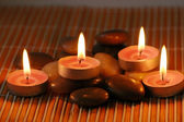 Candles on the pebbles for aromatherapy session — Stock Photo