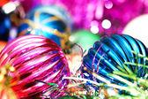 Colourful christmas decoration on a shiny background — Stock Photo