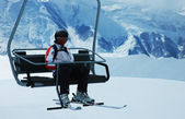 Skier on chair lift at ski resort — Stock Photo