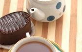 Cup of tea, chocolate cake and pot — Stock Photo