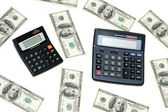 Dollars and calculators isolated on the white — Stock Photo