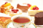 Selection of sweet cakes and tea on the table — Stock Photo