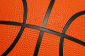 Close up of orange basketball with black lines — Stock Photo