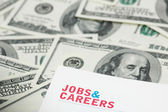 "Employment concept - ""Job and careers"" words over dollars — Stock Photo"