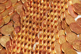 Rows of golden coins arranged as pattern — Stockfoto