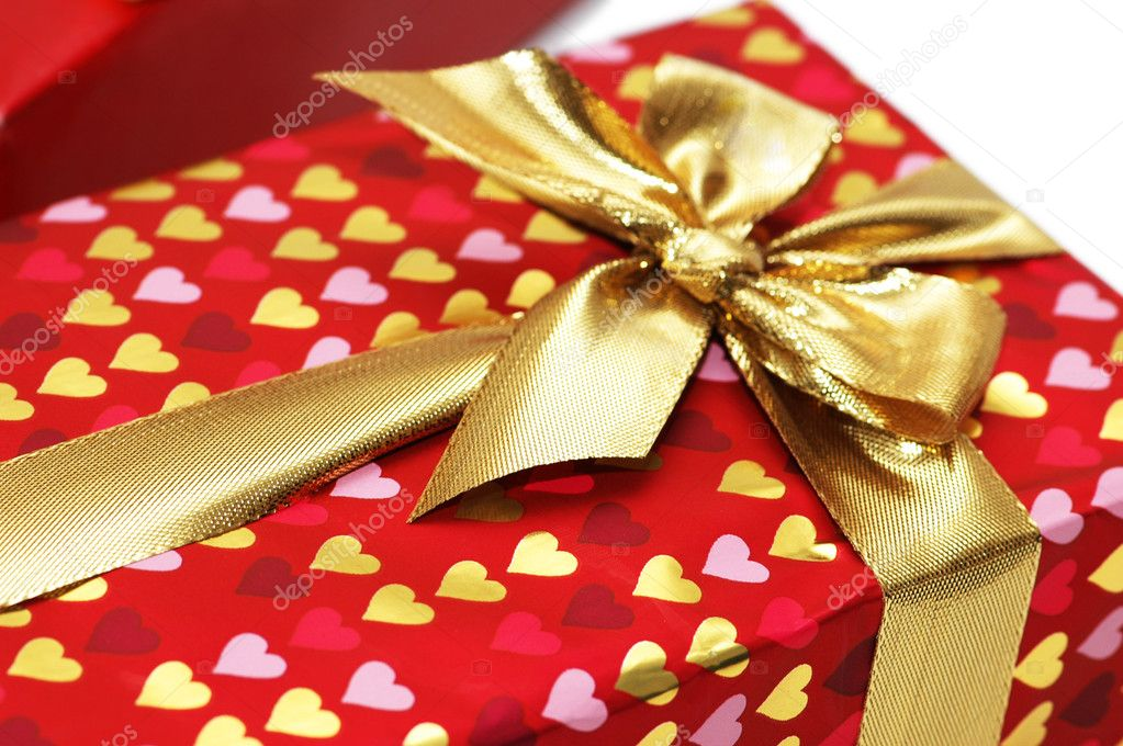 Close up of gift box with golden  ribbon — Stock Photo #4362287