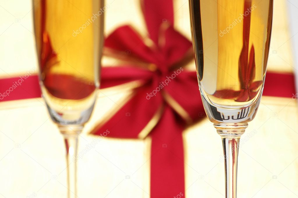 Wine glass and giftbox at the background — Stock Photo #4364559