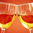 Two wine glasses on the biege  background — Stock Photo