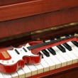 Musical concept - Rock guitar on the piano keys — Stock Photo