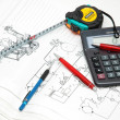 Design drawings, calculator, pens and measuring tape — Stock Photo #4374736