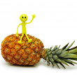 Stock Photo: Smilies sitting on top of pineapple isolated on white
