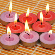 An array of candles for aromatherapy session — Stock Photo