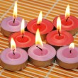 An array of candles for aromatherapy session - Stockfoto