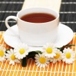 Cup of tea with herbs and daisies — Stock Photo #4379757