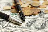Two ballpens over the hundred dollar banknotes — Stock Photo