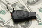 Car remote over the hundred dollar banknotes — Stock Photo