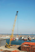 Crane at construction site in the port — Stock Photo