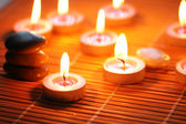 Candles and pebbles for spa session - shallow DOF — Stock Photo