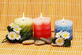Candles, flowers and pebbles for spa treatment — Stock Photo