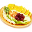 Fruit salad in the plate isolated on the white — Stok fotoğraf