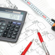 Design drawings, calculator, pens and measuring tape — Stock Photo #4380758