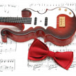 Guitar and bow tie over the sheet of printed music — Stock Photo