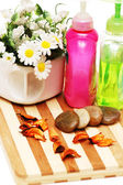 Stones, petals and balms for aromatherapy session — Stock Photo