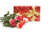 Gift box and bunch of flowers isolated on white — Stock Photo
