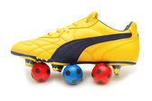 Yellow soccer footwear and color footballs isolated on white - — Stock Photo