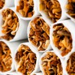 Close up of smoking cigarettes as antismoking concept - Stock Photo