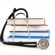 Concept of medical education with book and stethoscope — Stock Photo