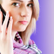 Blond girl talking on mobile phone — Stock Photo #4418750