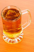 Beer glass on the wooden table — Stock Photo