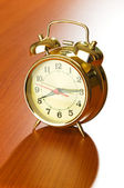 Alarm clock on the wooden table — Stock Photo