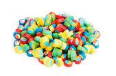 Barevné sladkosti izolovaných na bílém pozadí — Stock fotografie