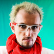 Man with red scarf against coloured background — Stock Photo