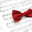 Bow tie on sheet of printed music — Stock Photo