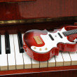 Stock Photo: Guitar on piano keys