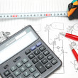 Design drawings, calculator, pens and measuring tape — Stock Photo #4426107