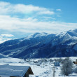 Small village and mountains covered with the snow — Stock Photo