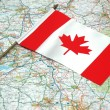 Flag of Canada over the map — Stock Photo #4426256