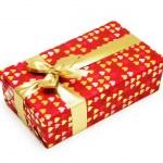 Gift box with shiny ribbons isolated on white — Stock Photo