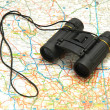Binoculars over the map of UK — Stock Photo