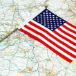US flag over the map - Stock Photo
