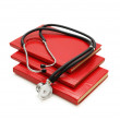 Stock Photo: Stack of study books and stethoscope isolated on white